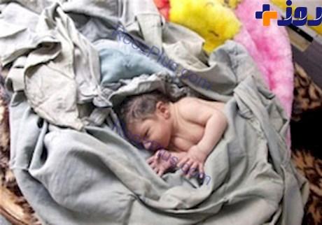 نوزاد در سطل آشغال + عکس