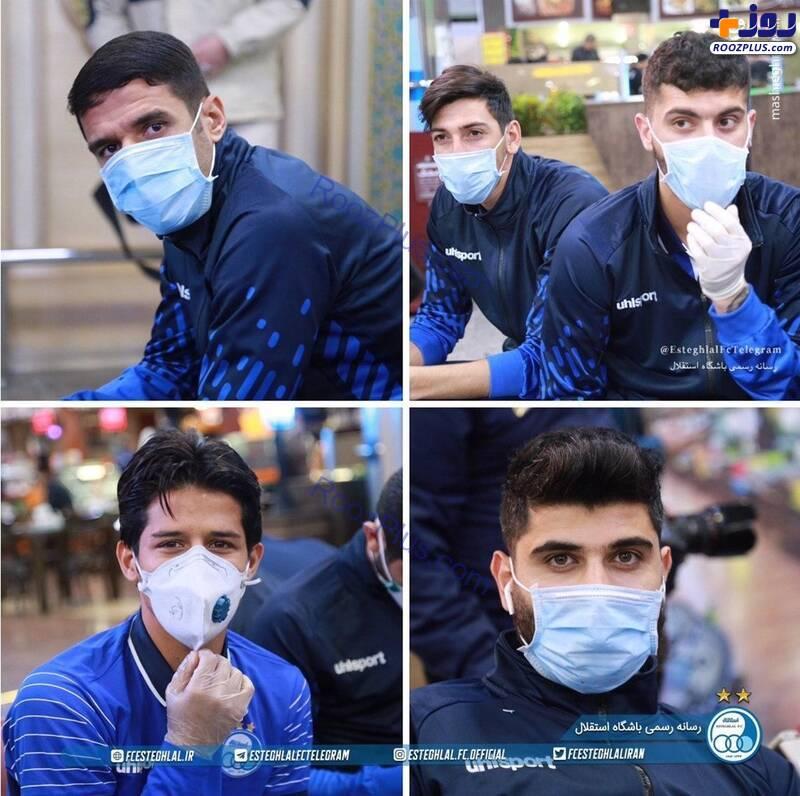 عکس/حضور استقلالیها در فرودگاه با ماسک
